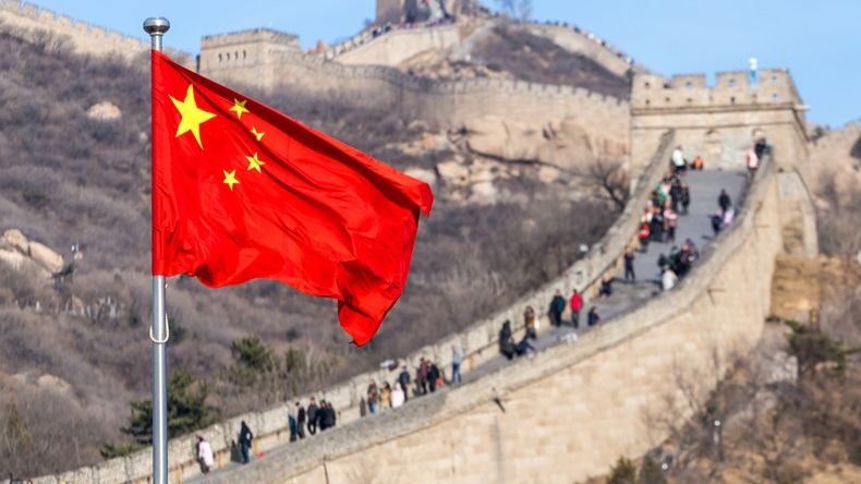 The Great Wall of China on the background and chinese red flag - Image