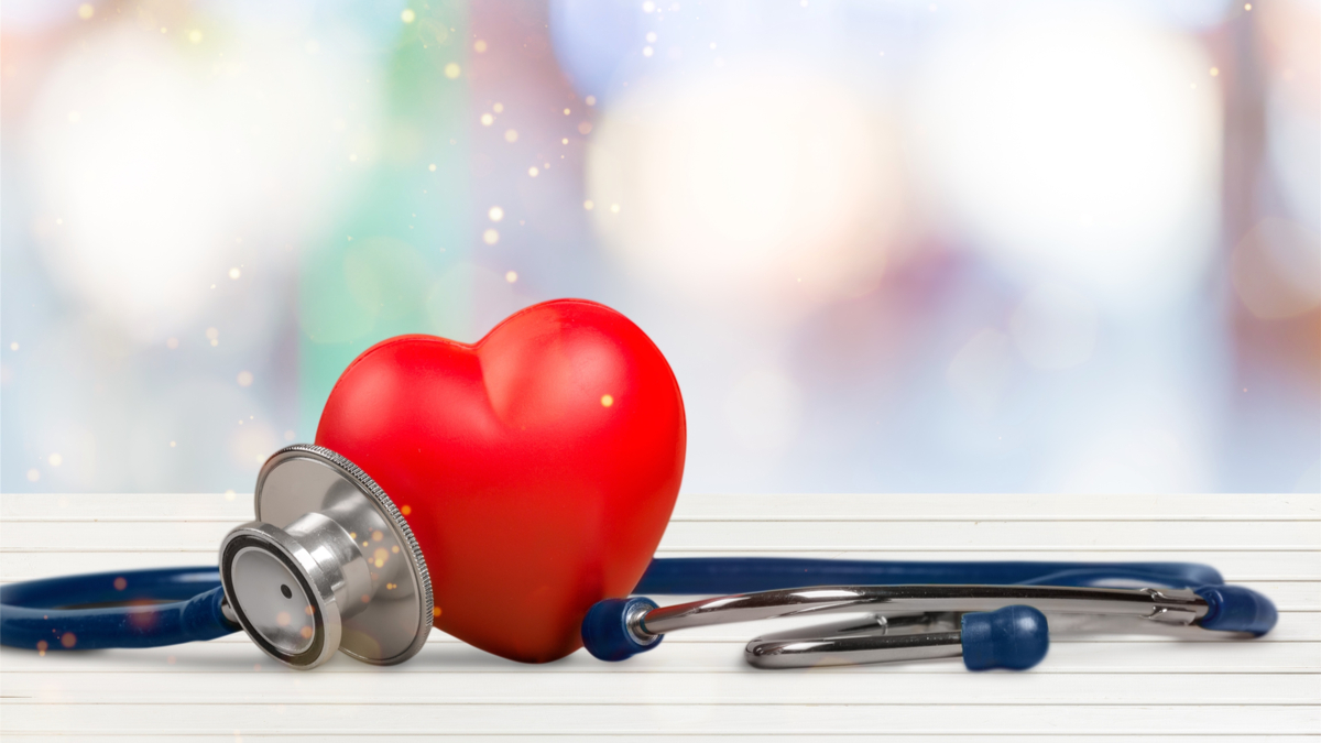 Red heart and a stethoscope on backgrouund - Image