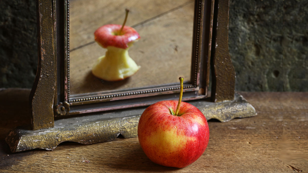 Apple reflecting in mirror
