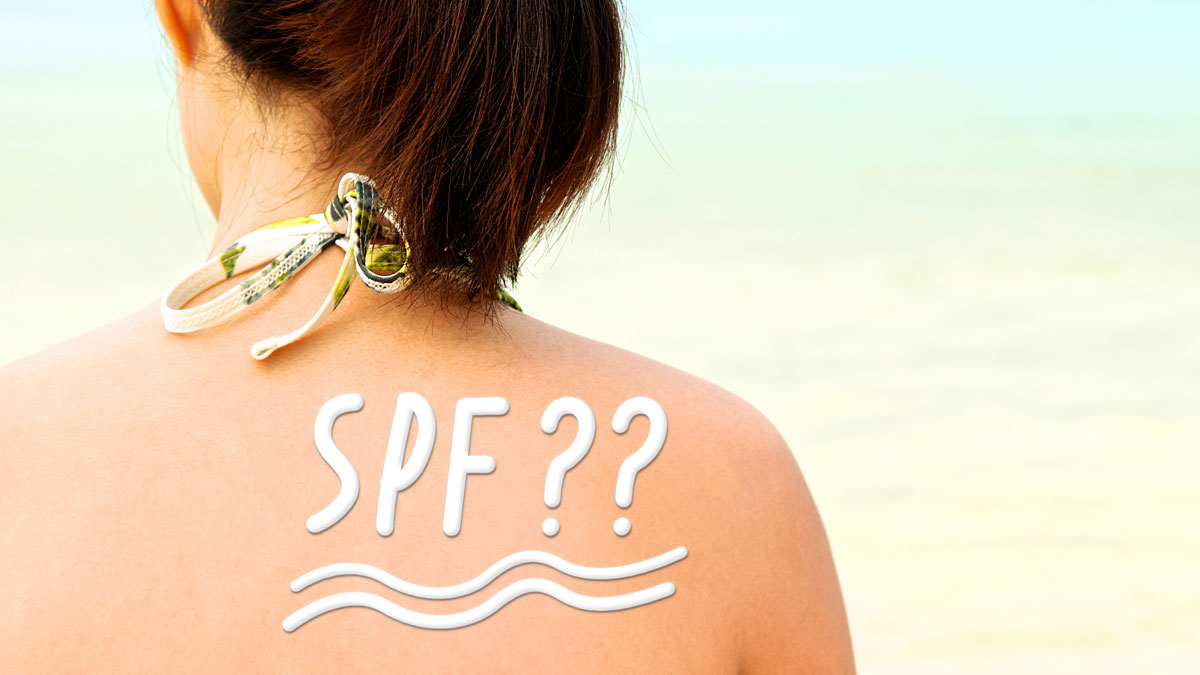 "Sunscreen lotion with word is ""SPF ??"" on asian woman skin, back view."