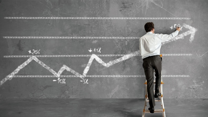 Businessman draws a statistical trend line