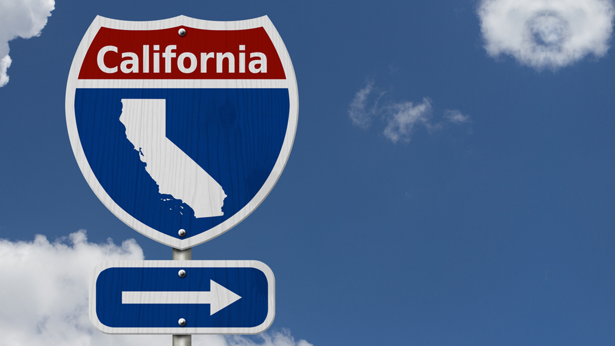 Road trip to California, Red, white and blue interstate highway road sign with word California and map of California with sky background 3D Illustration