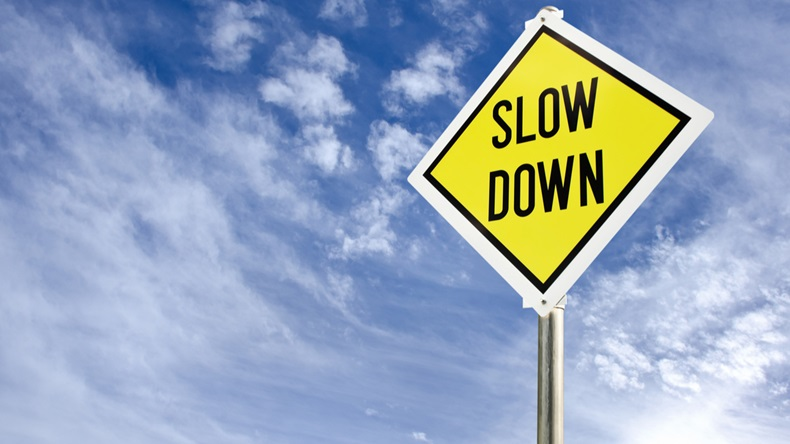 Slow-Down Sign_147945794_1200.jpg